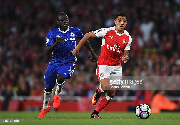 Golo Kante of Chelsea attempts to catch up with Alex Iwobi of Arsenal during the Premier League match between Arsenal and Chelsea at the Emirates...