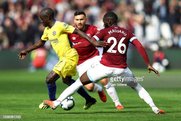 N'golo Kante of Chelsea battles for possession with Arthur Masuaku of West Ham United during the Premier League match between West Ham United and...