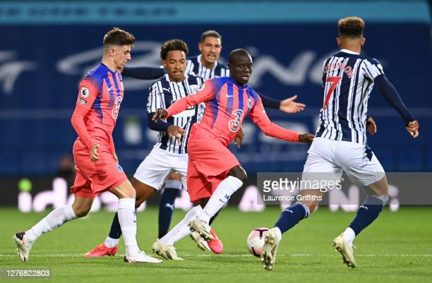 Golo Kante of Chelsea battles for possession with Callum Robinson of West Bromwich Albion during the Premier League match between West Bromwich...