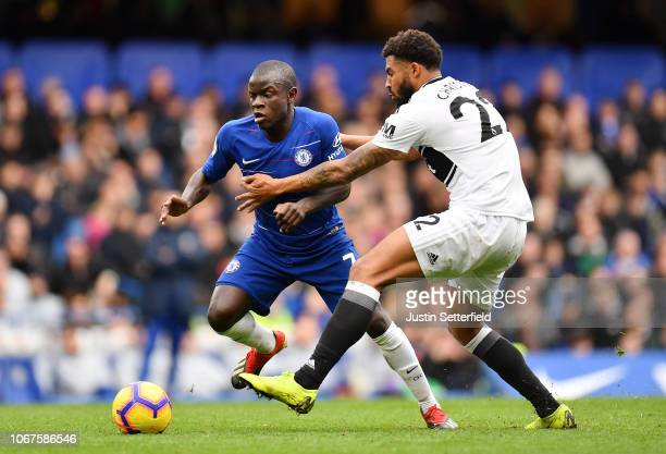 N'golo Kante of Chelsea battles for possession with Cyrus Christie of Fulham during the Premier League match between Chelsea FC and Fulham FC at...
