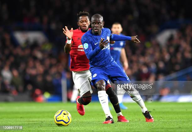 Golo Kante of Chelsea battles for possession with Fred of Manchester United during the Premier League match between Chelsea FC and Manchester United...
