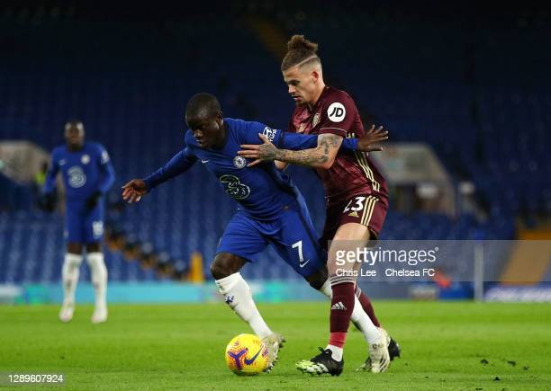 Golo Kante of Chelsea battles for possession with Kalvin Phillips of Leeds United during the Premier League match between Chelsea and Leeds United at...