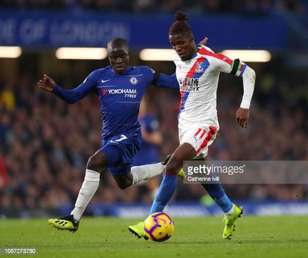 N'golo Kante of Chelsea battles for possession with Wilfried Zaha of Crystal Palace during the Premier League match between Chelsea FC and Crystal...