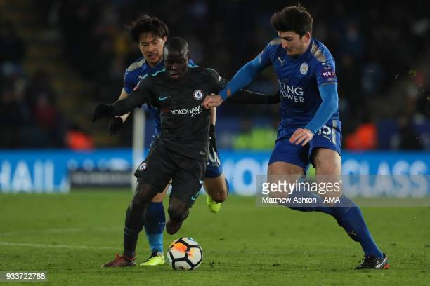 Golo Kante of Chelsea battles for the ball with Shinji Okazaki and Harry Maguire of Leicester City during the FA Cup Quarter Final match between...
