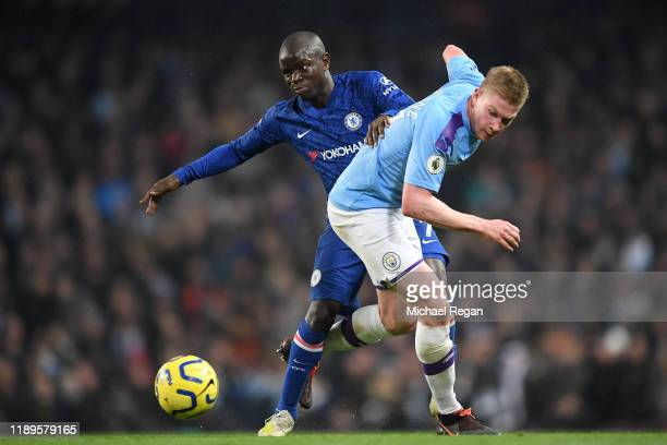 Golo Kante of Chelsea battles with Kevin De Bruyne of Manchester City during the Premier League match between Manchester City and Chelsea FC at...