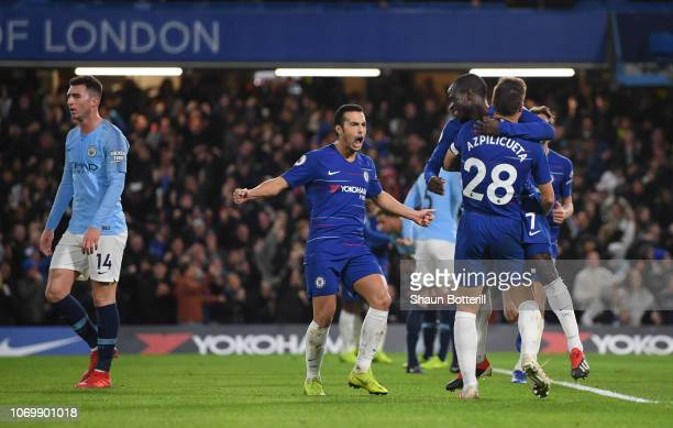 N'golo Kante of Chelsea celebrates after scoring his team's first goal with his team mates during the Premier League match between Chelsea FC and...