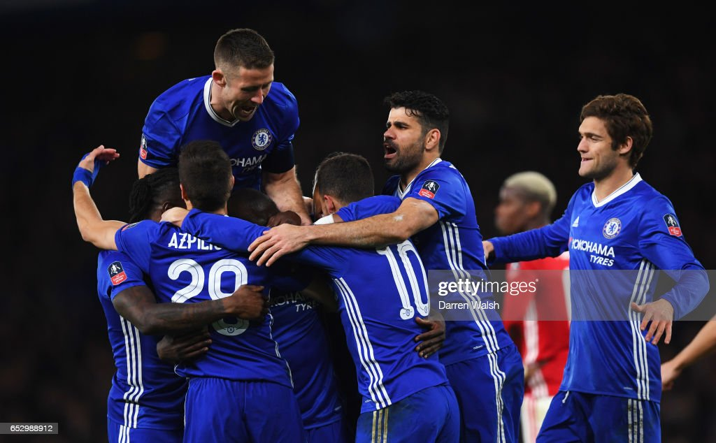 N'Golo Kante of Chelsea (obscured) celebrates as he scores their first goal with team mates during The Emirates FA Cup Quarter-Final match between Chelsea and Manchester United at Stamford Bridge on March 13, 2017 in London, England.