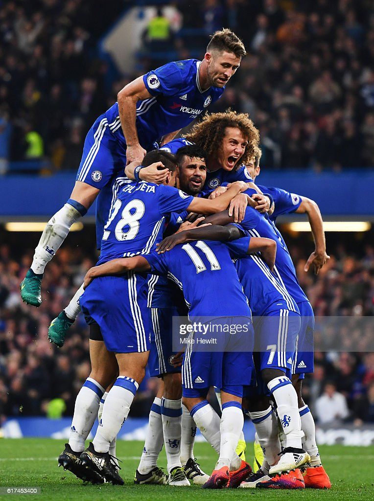N'Golo Kante of Chelsea celebrates scoring his sides fourth goal with team mates during the Premier League match between Chelsea and Manchester United at Stamford Bridge on October 23, 2016 in London, England.