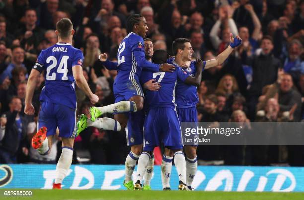 Golo Kante of Chelsea celebrates with team mates as he scores their first goal during The Emirates FA Cup QuarterFinal match between Chelsea and...