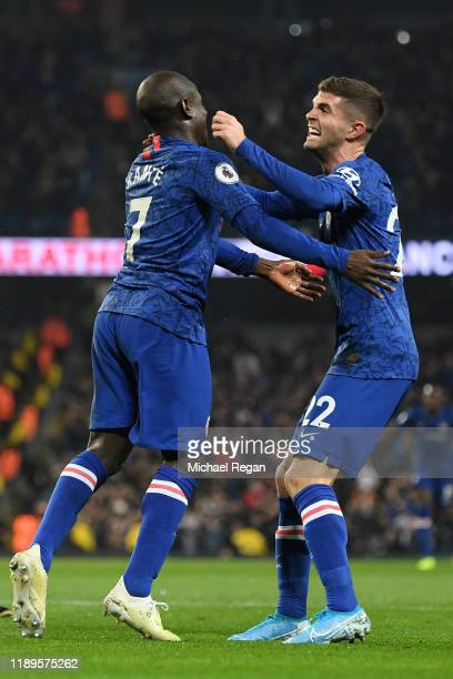 Golo Kante of Chelsea celebrates with teammate Christian Pulisic after scoring his team's first goal during the Premier League match between...