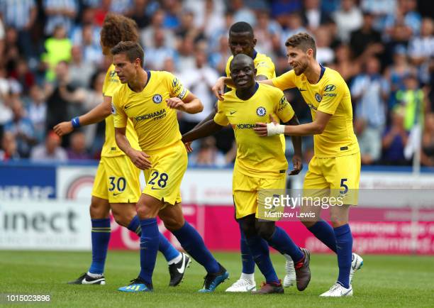 N'golo Kante of Chelsea celebrates with teammates after scoring his team's first goal during the Premier League match between Huddersfield Town and...