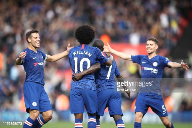 Golo Kante of Chelsea celebrates with teammates after scoring his team's third goal during the Premier League match between Southampton FC and...
