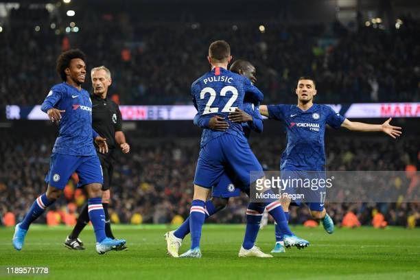 Golo Kante of Chelsea celebrates with teammates after scoring his team's first goal during the Premier League match between Manchester City and...