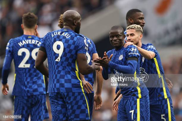 Golo Kante of Chelsea celebrates with teammates Romelu Lukaku and Jorginho after his shot takes a deflection from Eric Dier of Tottenham Hotspur ,...