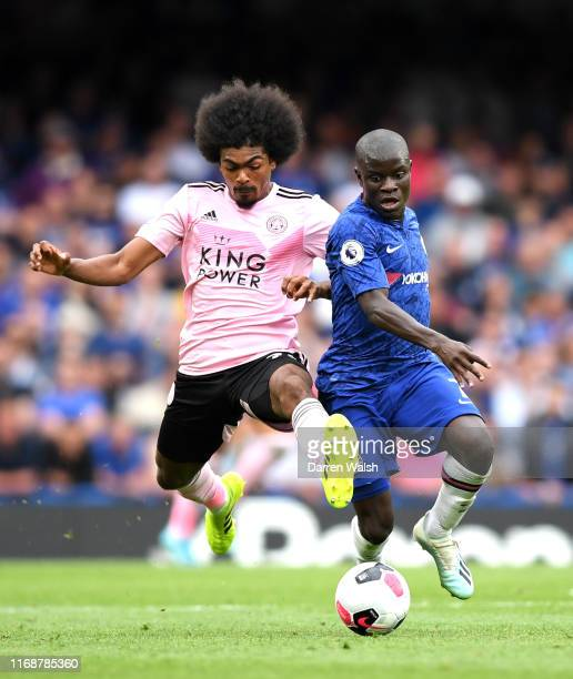 Golo Kante of Chelsea challenges for the ball with Hamza Choudhury of Leicester City during the Premier League match between Chelsea FC and Leicester...
