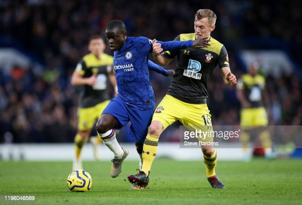 Golo Kante of Chelsea challenges for the ball with James WardProwse of Southampton during the Premier League match between Chelsea FC and Southampton...
