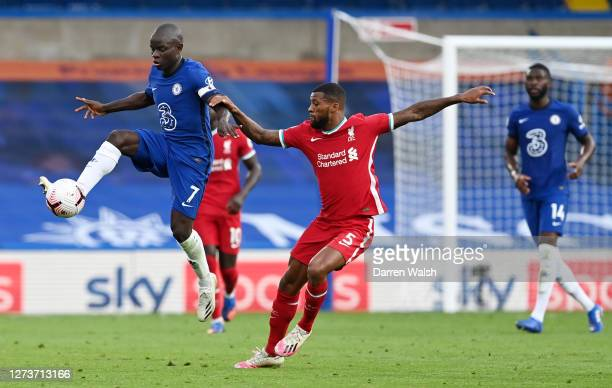 Golo Kante of Chelsea controls the ball ahead of Georginio Wijnaldum of Liverpool during the Premier League match between Chelsea and Liverpool at...