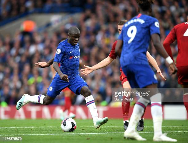 Golo Kante of Chelsea drives on to score his team's first goal during the Premier League match between Chelsea FC and Liverpool FC at Stamford Bridge...