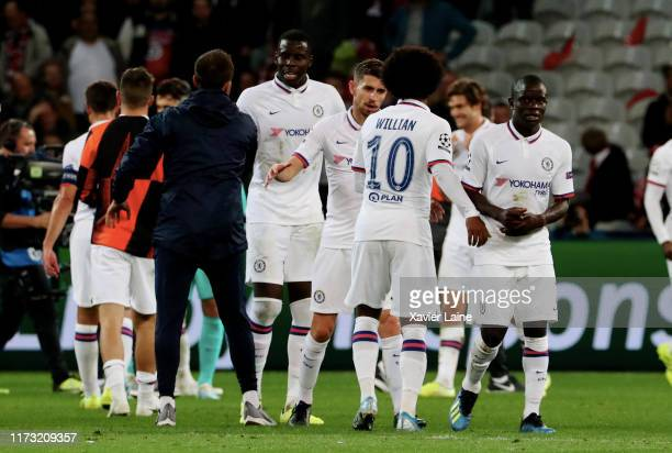 Golo Kante of Chelsea FC reacts after the victory with Kurt Zouma Willian and teammattes during UEFA Champions League group H match between Lille OSC...