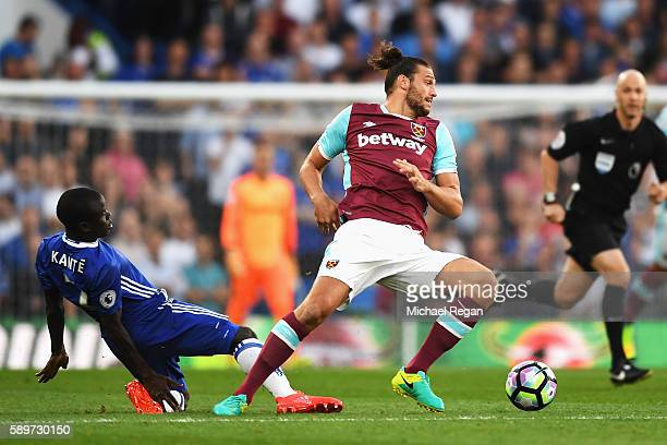 Golo Kante of Chelsea fouls Andy Carroll of West Ham United and receives a booking during the Premier League match between Chelsea and West Ham...