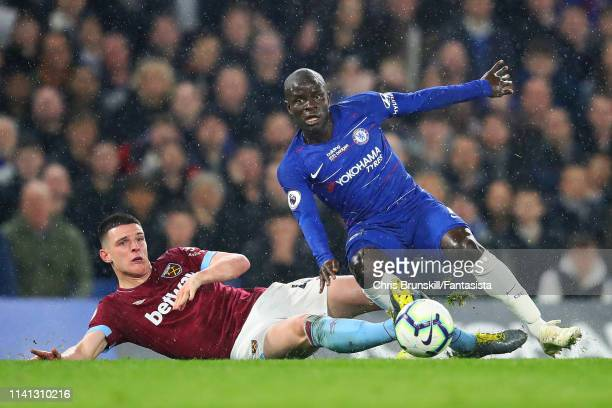 Golo Kante of Chelsea in action with Declan Rice of West Ham United during the Premier League match between Chelsea FC and West Ham United at...