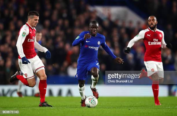 Golo Kante of Chelsea in action with Granit Xhaka of Arsenal during the Carabao Cup SemiFinal first leg match between Chelsea and Arsenal at Stamford...