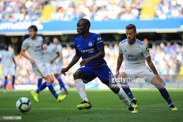 Golo Kante of Chelsea in action with Joe Bennett of Cardiff City during the Premier League match between Chelsea FC and Cardiff City at Stamford...