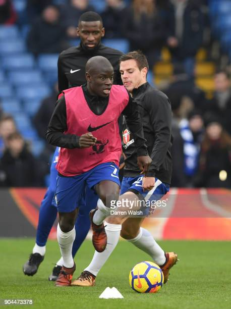 Golo Kante of Chelsea is challenged by Cesar Azpilicueta of Chelsea during the warm up prior to the Premier League match between Chelsea and...