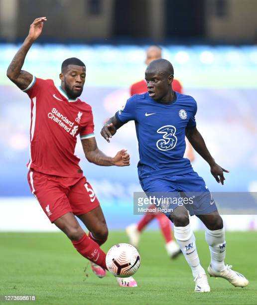 Golo Kante of Chelsea is challenged by Georginio Wijnaldum of Liverpool during the Premier League match between Chelsea and Liverpool at Stamford...