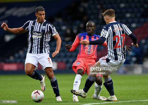 Golo Kante of Chelsea is challenged by Jake Livermore and Dara O'Shea of West Bromwich Albion during the Premier League match between West Bromwich...