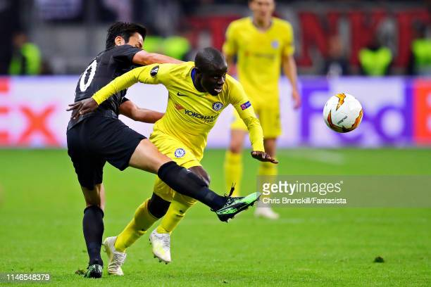 Golo Kante of Chelsea is challenged by Makoto Hasebe of Eintracht Frankfurt during the UEFA Europa League Semi Final First Leg match between...