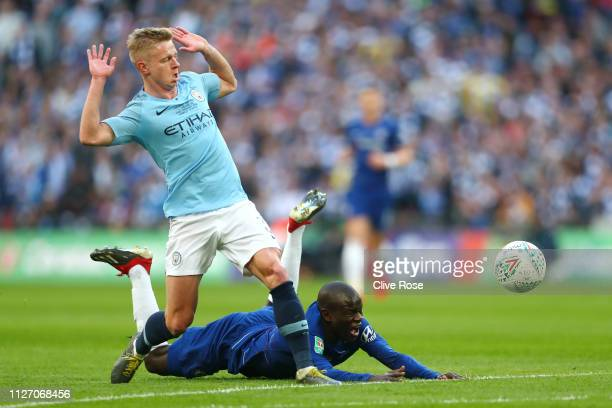 N'golo Kante of Chelsea is challenged by Oleksandr Zinchenko of Manchester City during the Carabao Cup Final between Chelsea and Manchester City at...