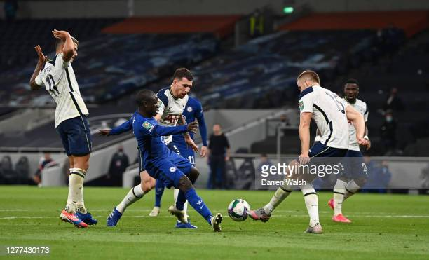 Golo Kante of Chelsea is challenged by PierreEmile Hojbjerg of Tottenham Hotspur and Eric Dier of Tottenham Hotspur during the Carabao Cup fourth...