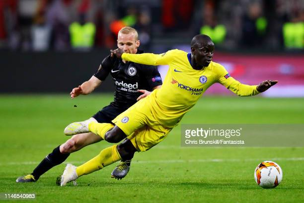 Golo Kante of Chelsea is challenged by Sebastian Rode of Eintracht Frankfurt during the UEFA Europa League Semi Final First Leg match between...