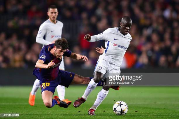 Golo Kante of Chelsea is challenged by Sergi Roberto of FC Barcelona during the UEFA Champions League Round of 16 Second Leg match between FC...