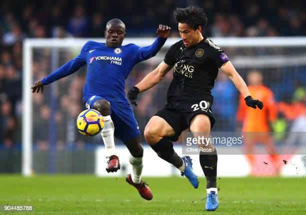 Golo Kante of Chelsea is challenged by Shinji Okazaki of Leicester City during the Premier League match between Chelsea and Leicester City at...