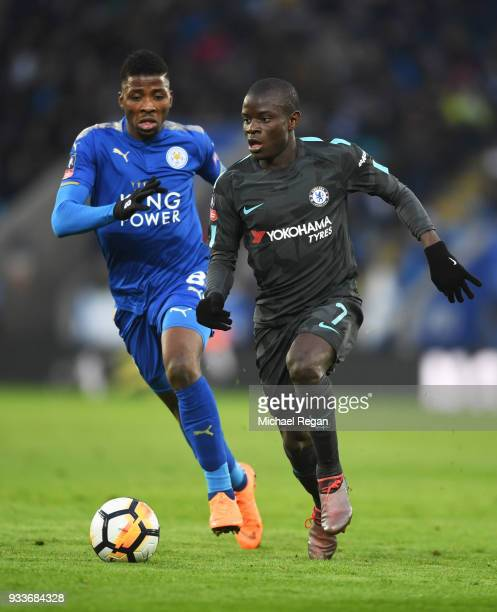 Golo Kante of Chelsea is chased by Kelechi Iheanacho of Leicester City during The Emirates FA Cup Quarter Final match between Leicester City and...