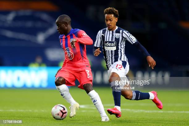 Golo Kante of Chelsea is closed down by Matheus Pereira of West Bromwich Albion during the Premier League match between West Bromwich Albion and...