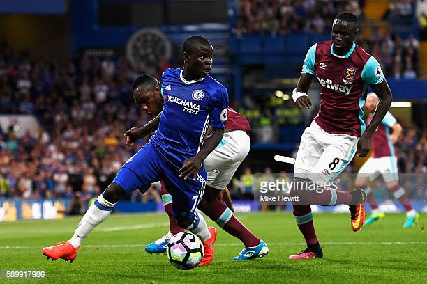 Golo Kante of Chelsea is closed down by Michail Antonio and Cheikhou Kouyate of West Ham United during the Premier League match between Chelsea and...
