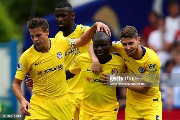Golo Kante of Chelsea is congratulated by his teammates Cesar Azpilicueta and Jorginho after scoring the opening goal during the Premier League match...