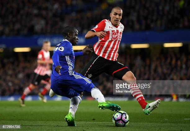 Golo Kante of Chelsea is faced by Oriol Romeu of Southampton during the Premier League match between Chelsea and Southampton at Stamford Bridge on...