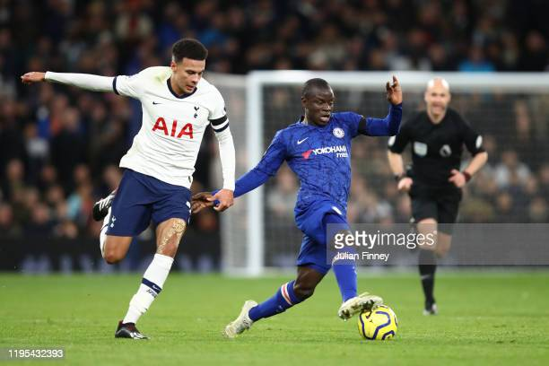 Golo Kante of Chelsea is tackled by Dele Alli of Tottenham Hotspur during the Premier League match between Tottenham Hotspur and Chelsea FC at...
