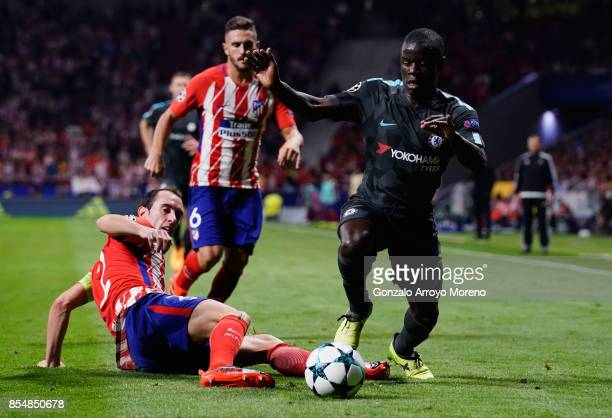 Golo Kante of Chelsea is tackled by Diego Godin of Atletico Madrid during the UEFA Champions League group C match between Atletico Madrid and Chelsea...