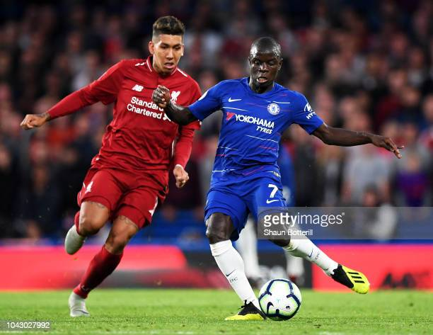 N'golo Kante of Chelsea is tackled by Roberto Firmino of Liverpool during the Premier League match between Chelsea FC and Liverpool FC at Stamford...