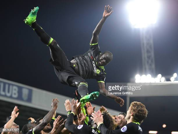 Golo Kante of Chelsea is thrown into the air in celebration after winning the title after the Premier League match between West Bromwich Albion and...