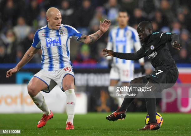 Golo Kante of Chelsea runs with the ball avoiding pressure from Aaron Mooy of Huddersfield Town during the Premier League match between Huddersfield...