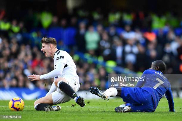 N'golo Kante of Chelsea tackles Tom Cairney of Fulham during the Premier League match between Chelsea FC and Fulham FC at Stamford Bridge on December...
