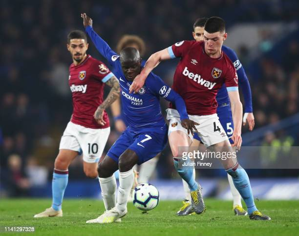 N'golo Kante of Chelsea tussles with Declan Rice of West Ham United during the Premier League match between Chelsea FC and West Ham United at...