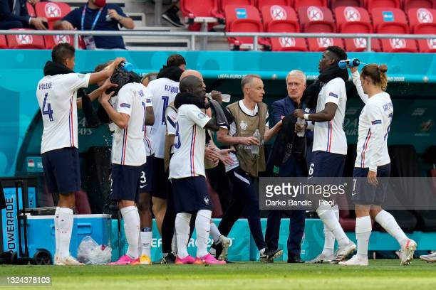 Golo Kante of France and team mates take a drink during the UEFA Euro 2020 Championship Group F match between Hungary and France at Puskas Arena on...