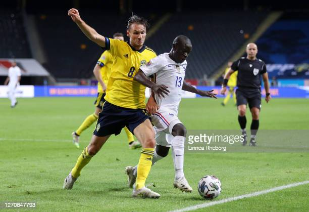 Golo Kante of France is challenged by Albin Ekdal of Sweden during the UEFA Nations League group stage match between Sweden and France at Friends...